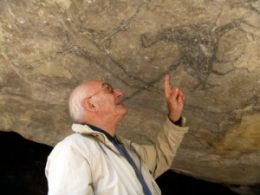 Professor Jean Clottes investigating rock art at Craigmore. Photo by Dr Yann-Pierre Montelle