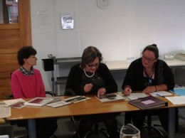 From left: Christine Denny, Maria Korako Tait and Karen Hubbard identifying images.