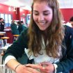 Nicole Spriggs (Ngāi Tahu ), from Lincoln High School,  getting close to an invertebrate in a UC lab.