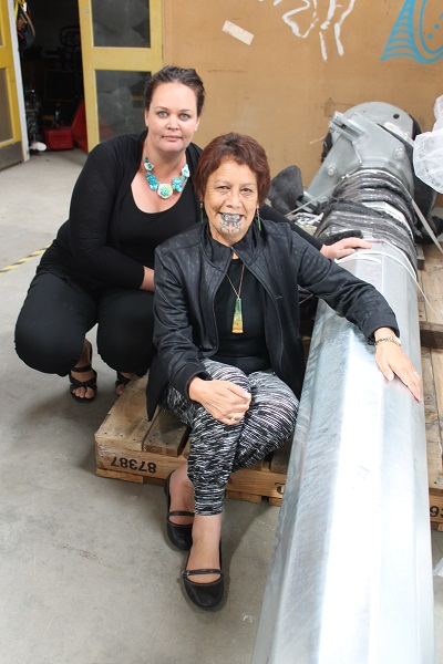 Sumaria Beaton of Awarua Synergy and Te Runaka o Awarua chair Hana Morgan with a section of a wind turbine to be erected at the Bluff Marae next month.