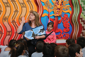 Bluff Community School principal Alison Cook  reading stories.