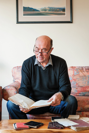 Edward Ellison with one of his great-grandfather's diaries.