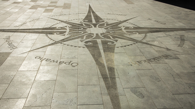 A 10 metre wide compass at the main entrance of the Christchurch Bus Interchange, highlights places of significance to Tūhaitara/Ngāi Tūāhuriri.