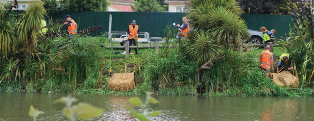 Volunteers installing bales along the Heathcote River.