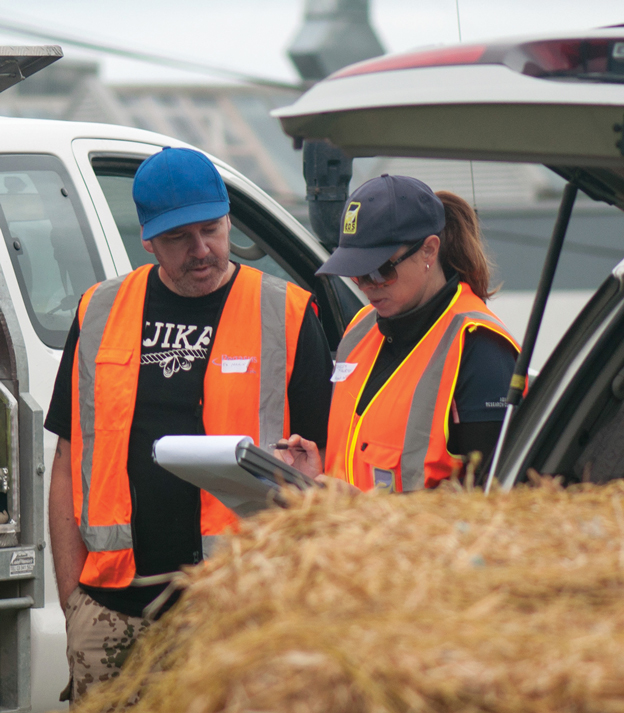 Project organisers Te Marino Lenihan and Shelley McMurtrie (EOS Ecology) checking gear lists for teams on the volunteer installation day.