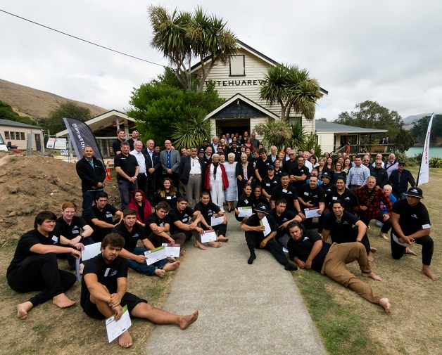 This year's new intake of Whenua Kura students (seated in foreground) are photographed with kaumātua from Koukourārata (Port Levy) and manuhiri.