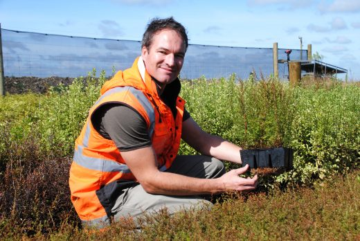 Ngāi Tahu Farming project manager Ben Giesen checks out new plants at the on-farm nursery.