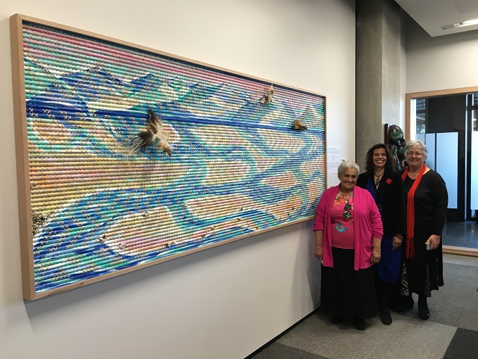 Reihana Parata, Priscilla Cowie and Morehu Flutey-Henare stand with one of their tukutuku panels in the new ECan building in Christchurch.