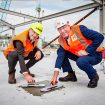 Ngāi Tahu Property chief executive David Kennedy and Steve Taw, Hawkins' South Island Regional Manager, poured the final concrete to complete the top floor.