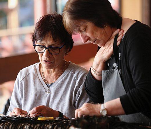 Te Rūnanga O Awarua co-ordinator Gail Thompson shows Sharon Malofie her progress.