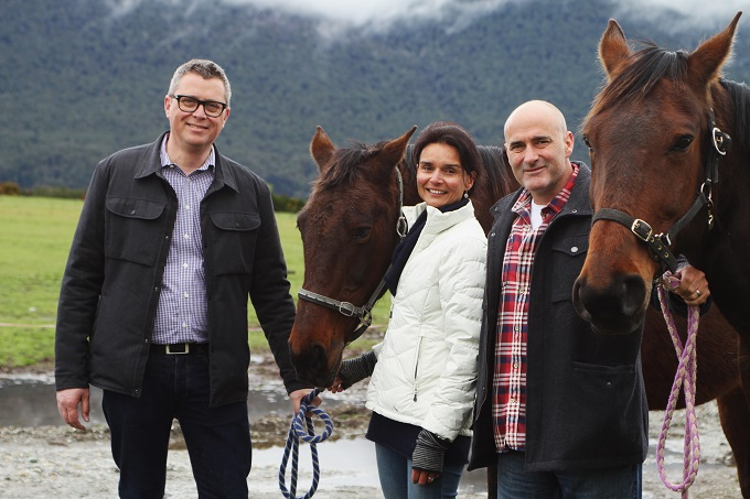 Ngāi Tahu Tourism Chief Executive Quinton Hall with current Dart Stables owners, Peter and Jenny Davies.
