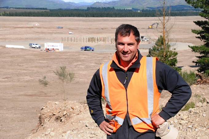 Rhys Narbey, Ngāi Tahu Farming Rural Development Manager, Balmoral takes in an overview of the new Pilot Farm development on cleared forest land.