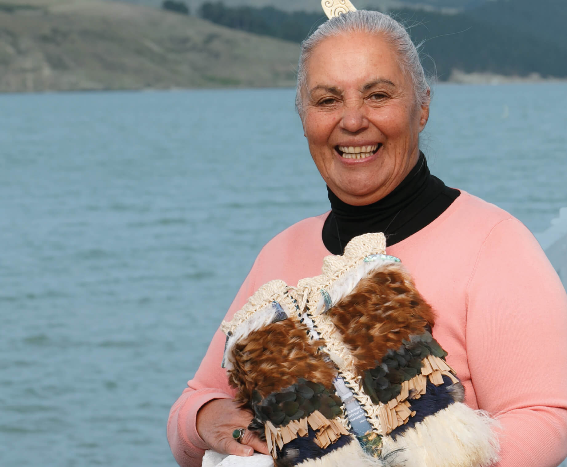 Yvette Couch-Lewis, governing chair of the Whaka-Ora Healthy Harbour project with the korowai woven by  Ngāti Wheke – photo credit: Shar Devine